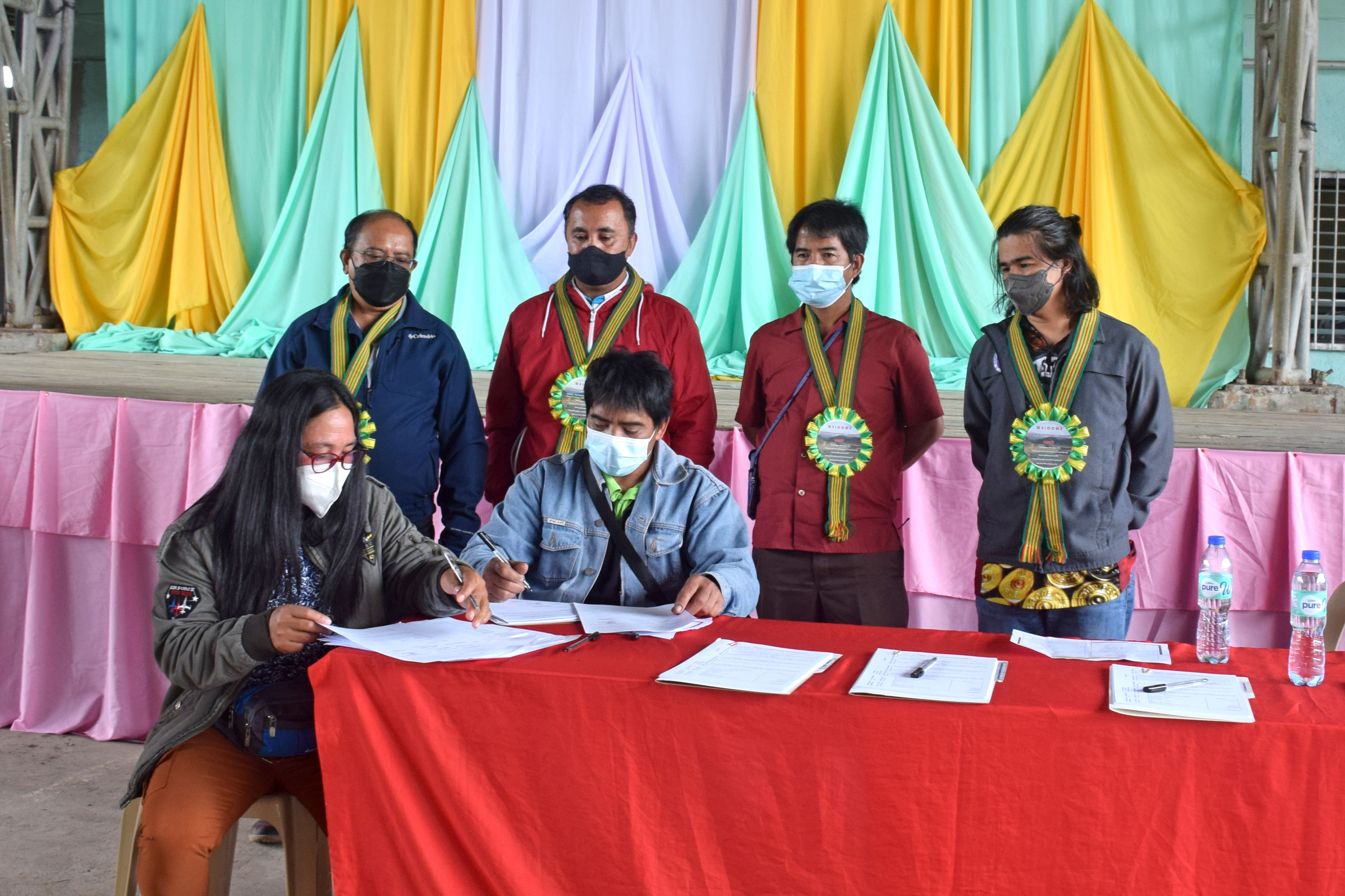 Irrigators' Association leaders in Ifugao acceptance papers of irrigation systems turned over to them as NIA and local officials serve as witnesses.