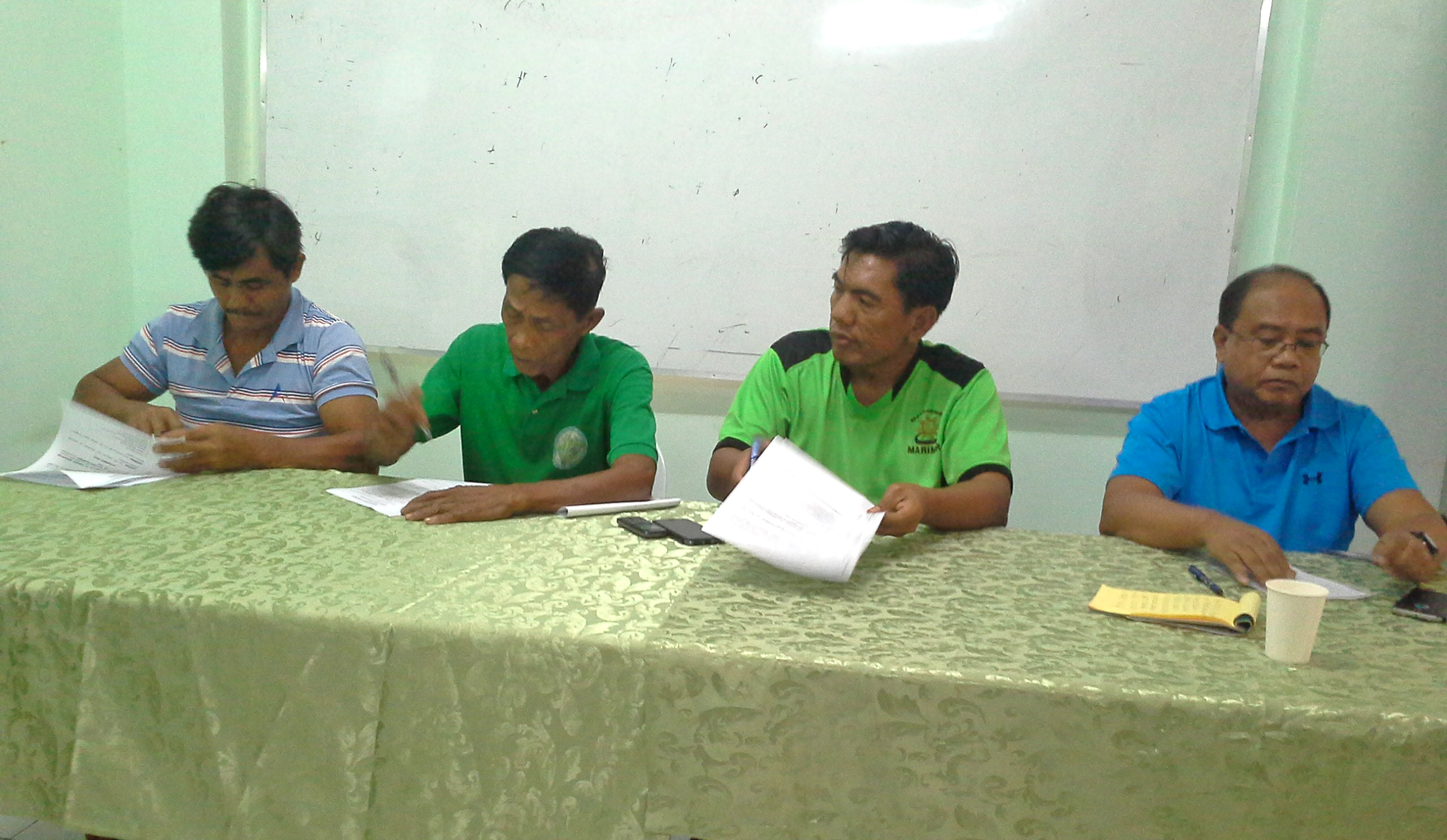 Members of the Tripartite Committee sign the MOA on the operation and maintenance of the Hapid Irrigation System. (from left to right) SB Napoleon Belingon, Committee on Agriculture of LGU Lamut; Mr. Salvador Balmores.Wagufi Fed. Pres.; Atty. Mariano Buyagawan, Jr.-Municipal Mayor  and Engr. Benito Espique, Jr., Acting Regionl Manager NIA-CAR