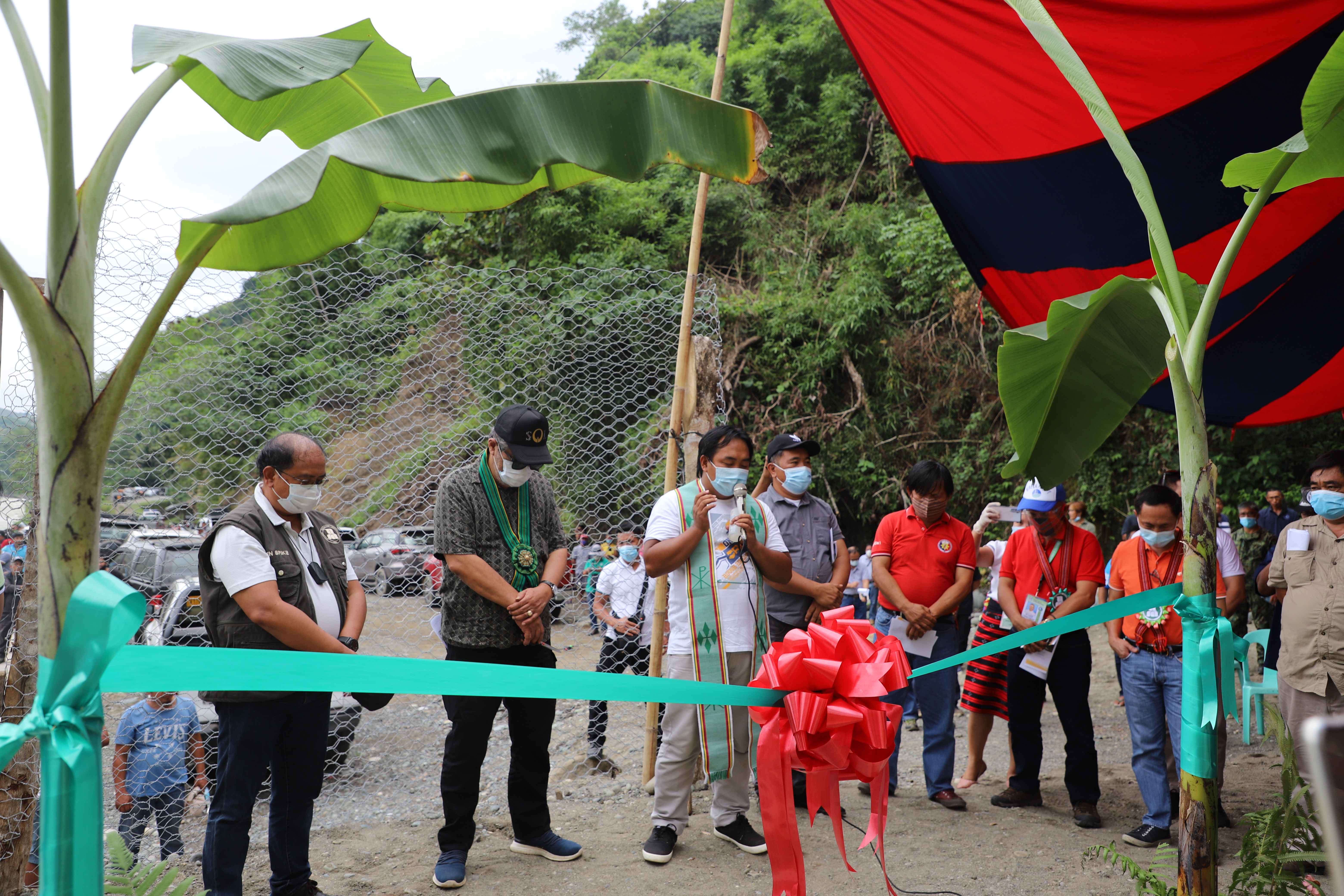 Inauguration of the newly completed diversion dam of the Hapid Irrigation System in Lamut, Ifugao on October 1, 2020 is led by Hon. Solomon Chungalao, Representative of the Lone District of Ifugao, Governor Jerry Dalipog, NIA-CAR Regional Manager Benito Espique, Jr., and NIA Ifugao Satellite Office Head Patrick Resurreccion witnessed by other local officials, regional heads of other agencies, NIA employees and farmer-beneficiaries.