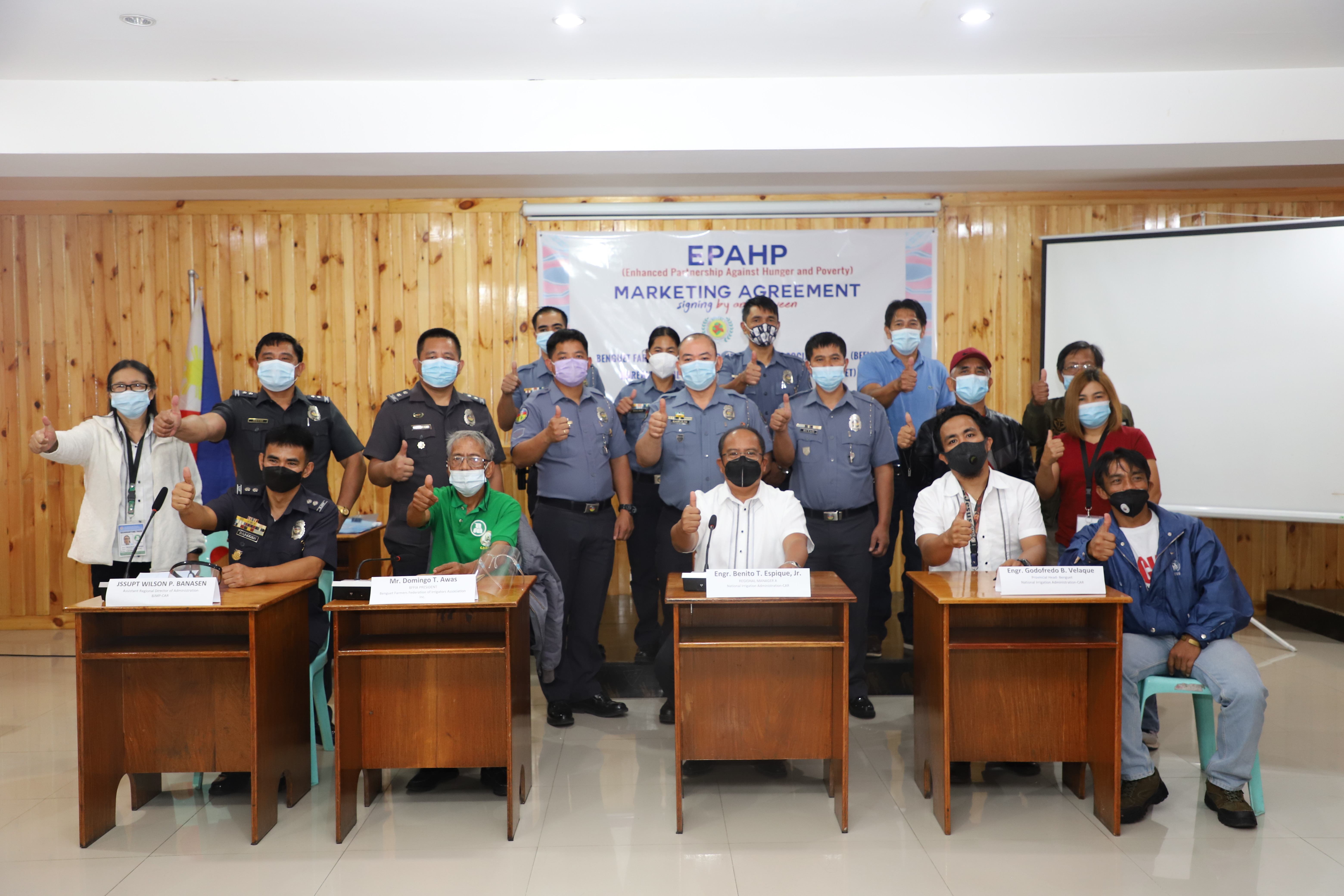 Officers of the Benguet Farmers Federation of Irrigators' Association (BFFIA) and Bureau of Jail Management and Penology (Benguet) together with officials of NIA-CAR pose for a group photo after the signing of Marketing Agreement by and between BFFIA and BJMP at the NIA Cordillera Farmers' Training Center in Wangal, La Trinidad, Benguet on June 28, 2021.