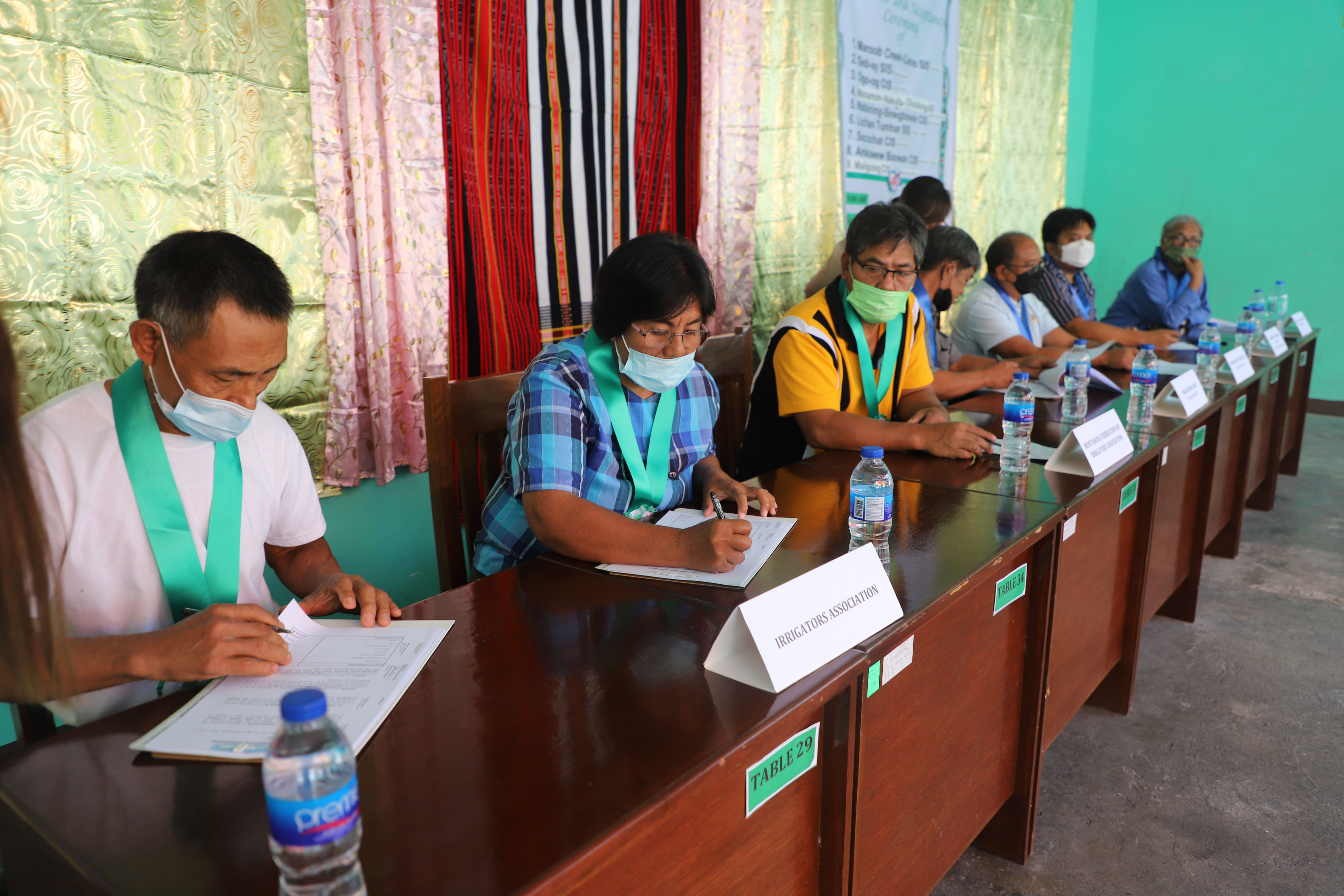 Leaders of Irrigators' Associations sign turnover documents of nine irrigation projects turned over to them in a turnover ceremony at the NIA grounds in Brgy. Caluttit, Bontoc, Mountain Province on September 1, 2021.