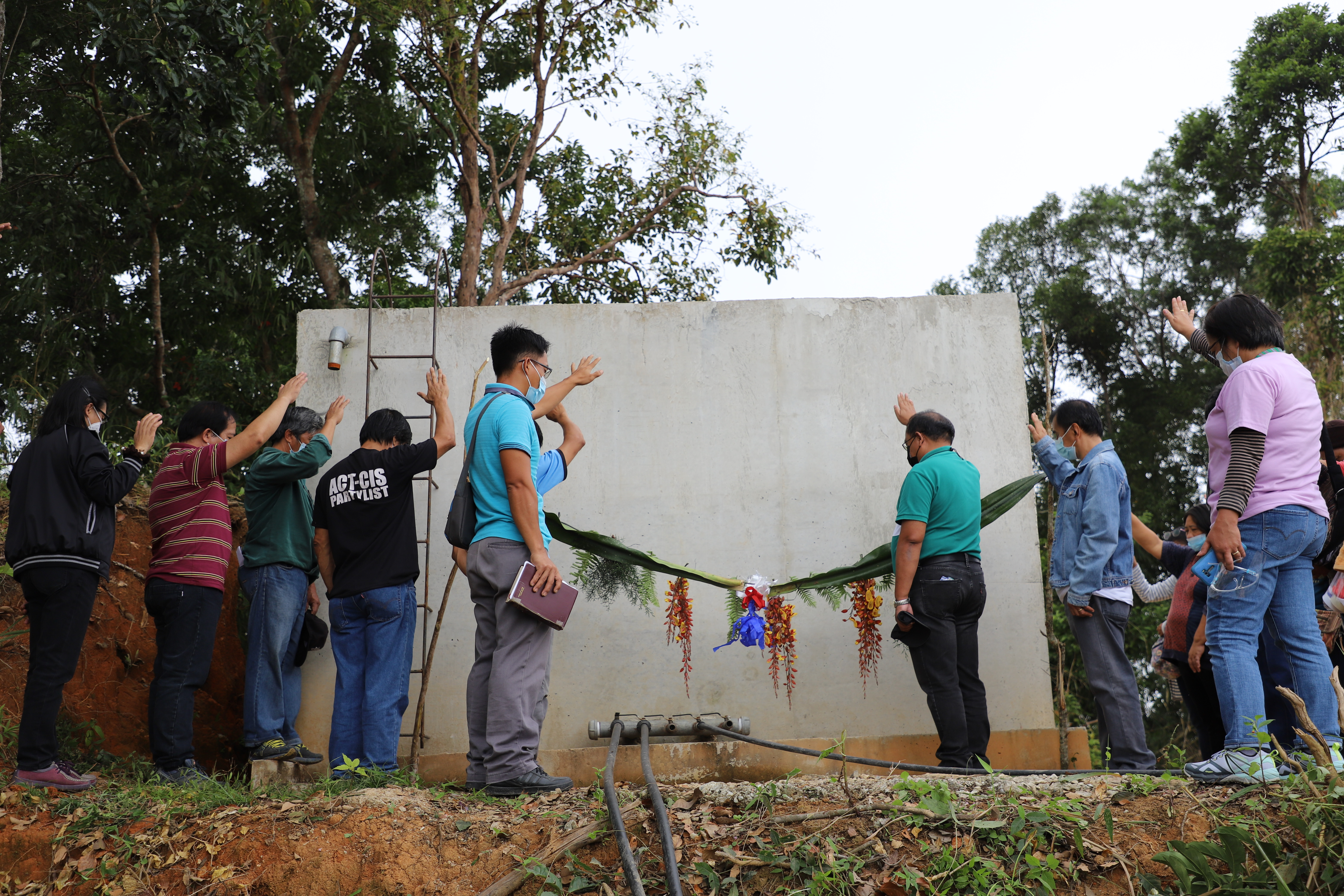 Implementers and various stakeholders of the Pongew Creek Alog Sablan Small Irrigation Project in Sablan, Benguet bless the irrigation facilities before the system is turned over to DAMS Irrigators' Association  on December 4, 2020.