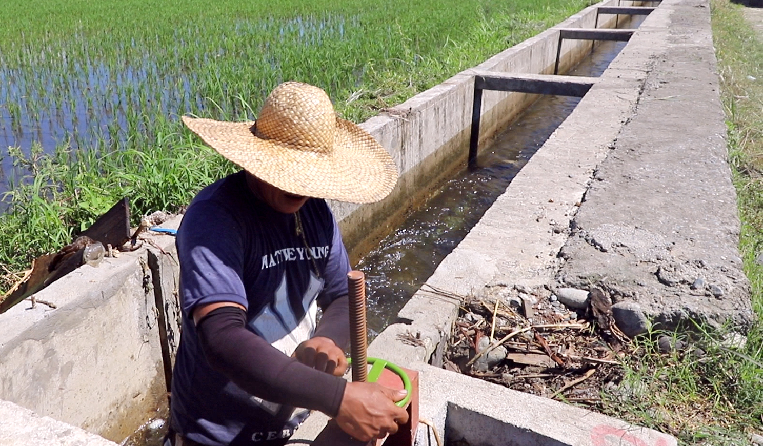 A member of the Jose Aniban Irrigators' Association learns the operation of the irrigation canal steel gate handwheel after the turnover ceremony of the Laya West Communal Irrigation Project Phase 2. The farmers' group will now be in charge of the operation and maintenance of the irrigation system.