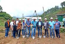 Engr. Benito Espique, Jr., NIA—CAR Acting Regional Manager, leads the groundbreaking ceremony of Lapalap River—Dagdag Small Irrigation Project in Brgy. Bangao, Buguias, Benguet. With him are municipal and barangay officials, church leaders and members of the Lapalap Dagdag Bangao Farmers Irrigators' Associations.
