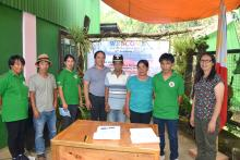 After signing of the turnover and acceptance documents, Pongayan Farmers' Association President Pauline Pad-eng (third from right), Barangay Captain Fernando Sasa (2nd from right) and other members of the association stand tall with Engr. Godofredo Velaque (fourth from left) and Ms. Paulita P. Yagyagan of NIA-CAR (extreme right).